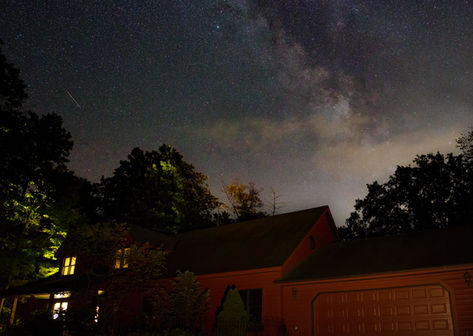 Stars above a cabin in the Wisconsin woods