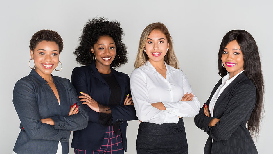 Group of businesswomen working together in an office.jpg