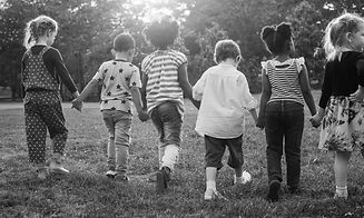Black and white image of children walkin