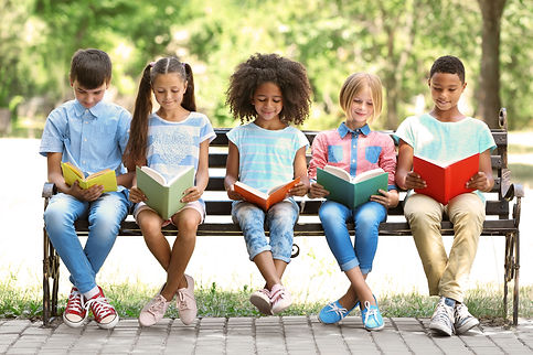 Cute kids reading books on bench.jpg