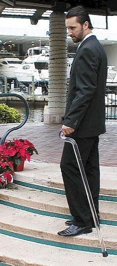 man displaying use of acrylic walking cane