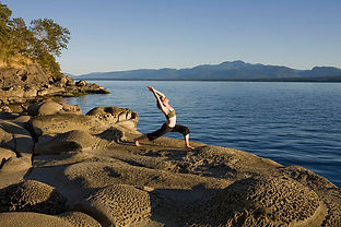 a-woman-does-yoga-at-sunset-taylor-s-ken