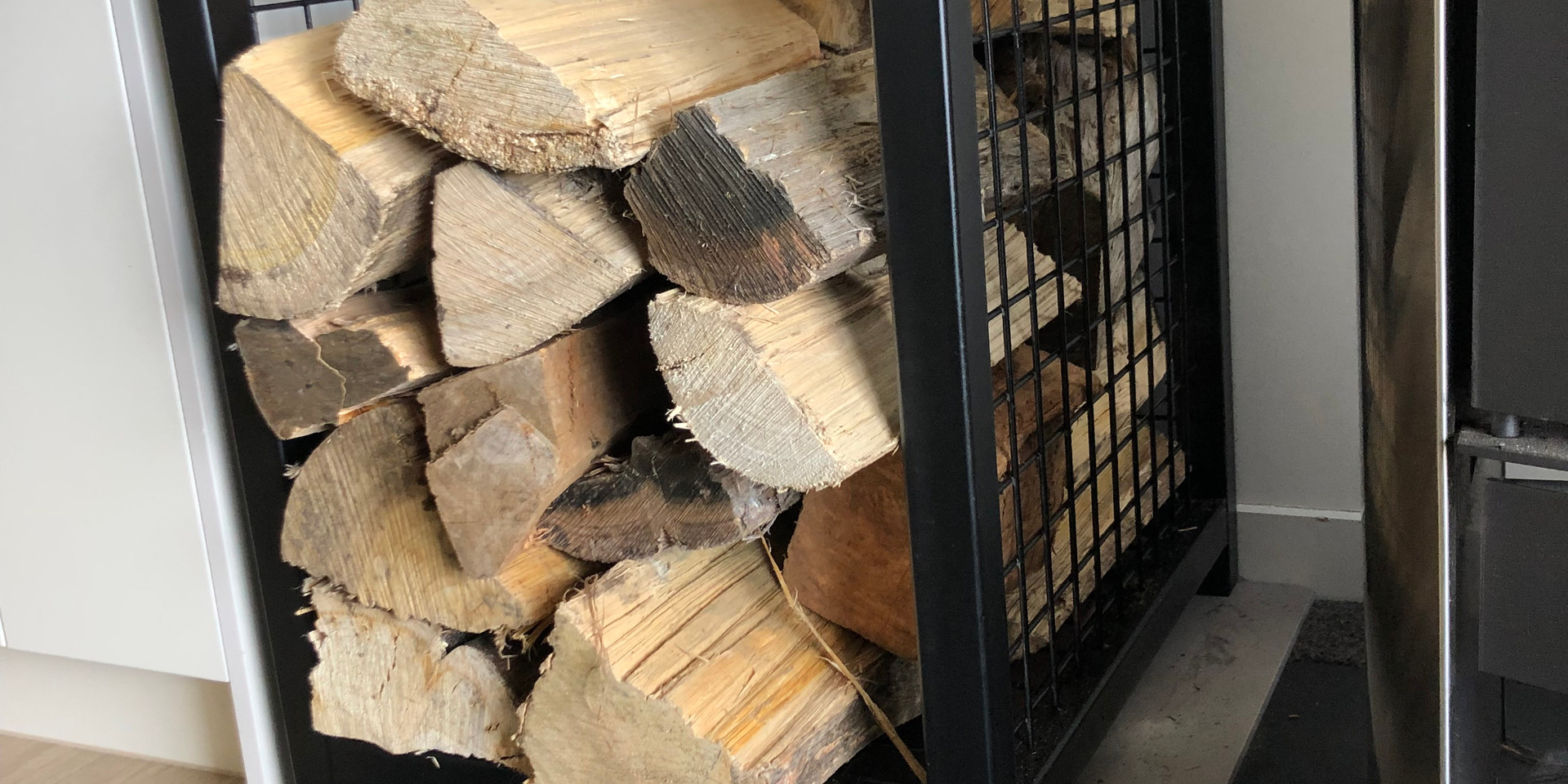 Interior firewood stacker