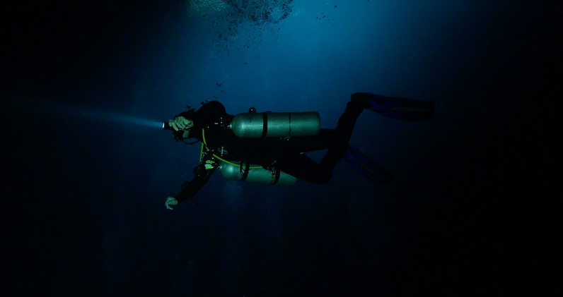 Diving into The Pit near Tulum Mexico