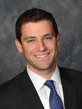 Adam J. Weiss
