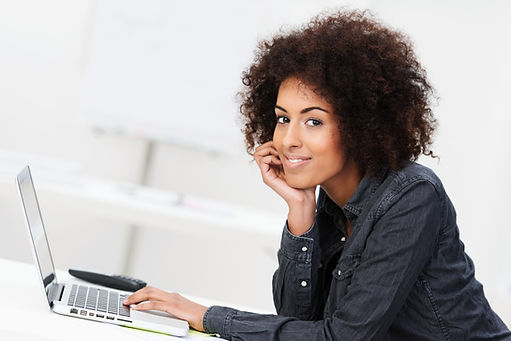 Woman with laptop at home for online therapy in Missouri with a licensed online counselor in Missouri. St. Louis based Marble Wellness provides online counseling in Missouri for depression, anxiety, mothers, and more. Online therapy for women in Missouri is here for you!