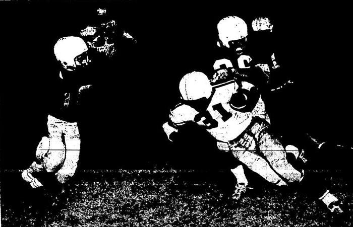 Star Capitol Hill defender Jim Dobson drags down Douglass's Joe Bruner after a short gain
