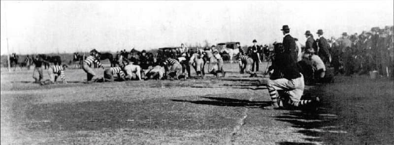 Coach Vernon Parrington, wearing hat on the sideline, leads the Oklahoma Sooners against the Arkansas City (KS) Town Team in 1899. Parrington was OU's first head football coach and crafted one of the Sooners' best career winning percentages.