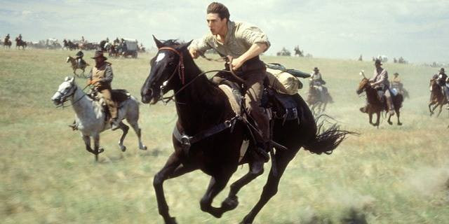 "Tom Cruise, playing an Irish immigrant riding for land in the Cherokee Outlet Run of '93, in Duncan, OK native Ron Howard's epic film ""Far and Away."""