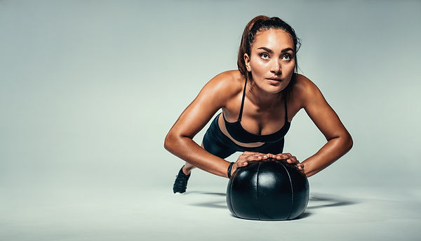 Fit Woman Doing Push Up On Medicine Ball