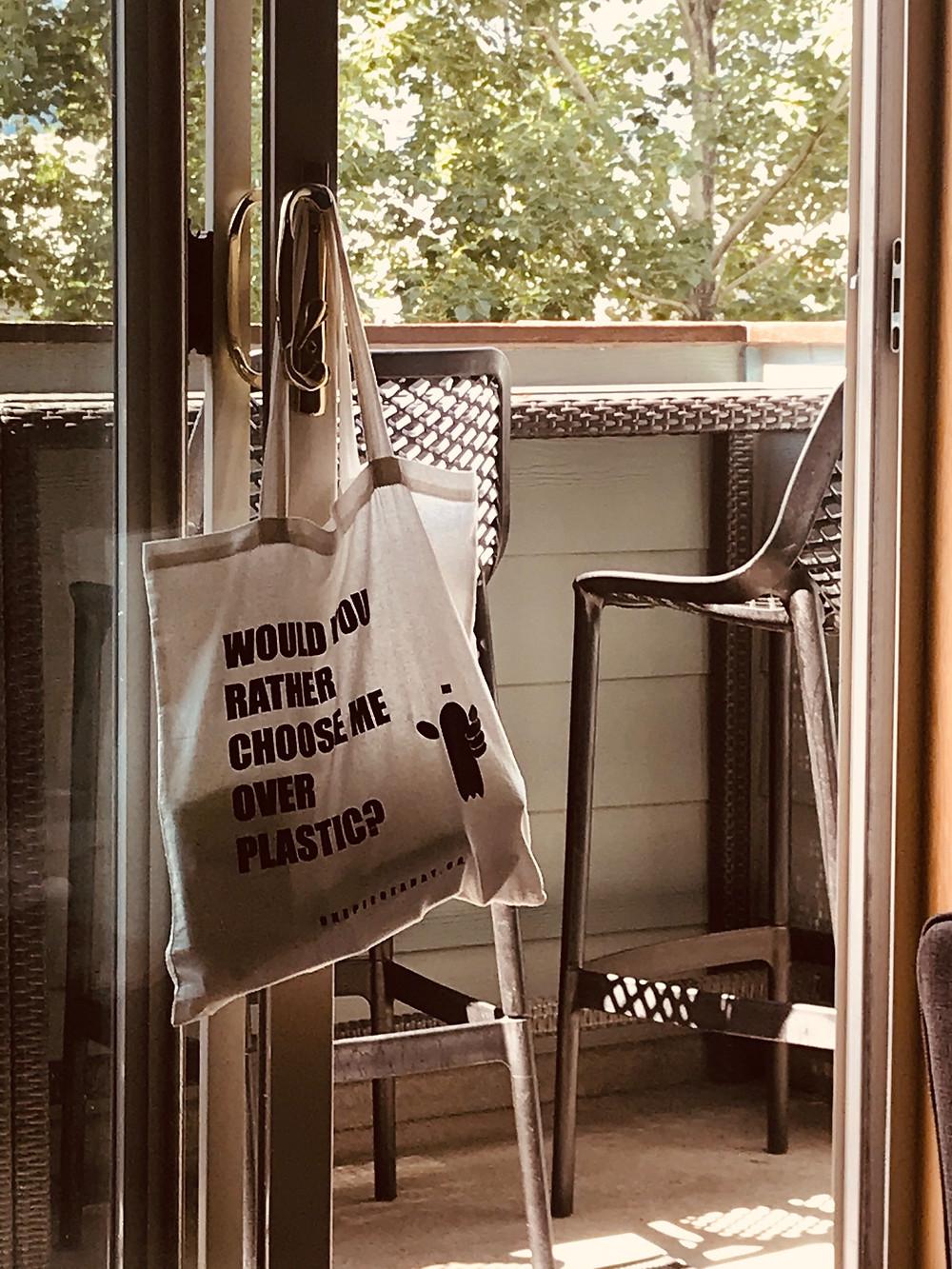 Reusable Tote Bag hanging on balcony door