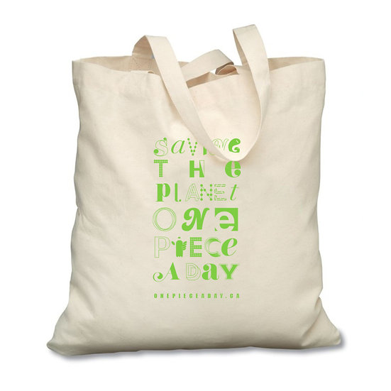 Saving the planet one piece a day green typography. Our eco-friendly, reusable cotton tote bag.