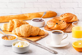 Breakfast with coffee and croissants, se