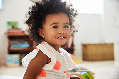 Happy Baby Girl Playing With Toys In Pla