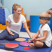 Child with a band on eyes during sensory