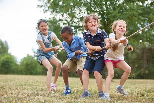 Interracial group of kids playing at the