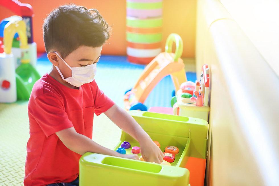 Cute children boy playing indoor  playgr