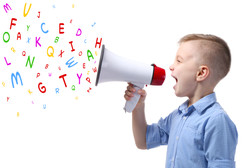 Little boy with megaphone and letters on white background