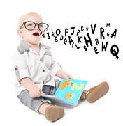 Little boy in glasses with first book an