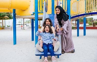 Arabian family spending time in a park.j