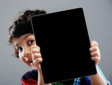 Cute kid with Tablet.jpg