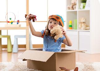Kid child pilot flying a cardboard box i
