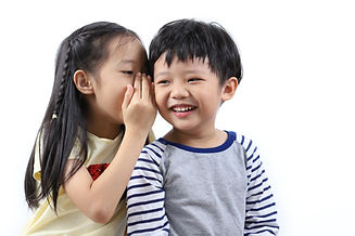 Portrait of happy Asian kids sharing sec