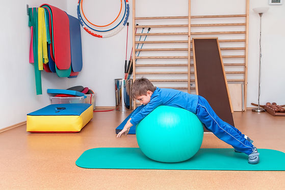 Child is therapeutic exercises in the gy