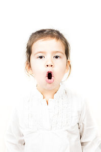 Portrait of little girl with mouth open.