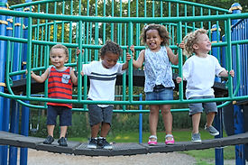 a diverse group of children are playing