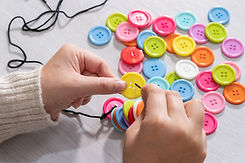 Hands holding a colourful button.jpg
