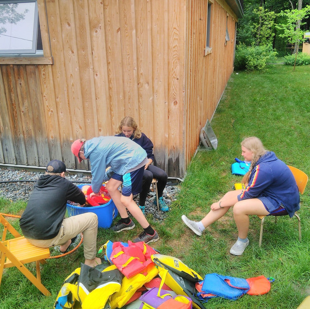 Leaders-In-Training rinsing lifejackets