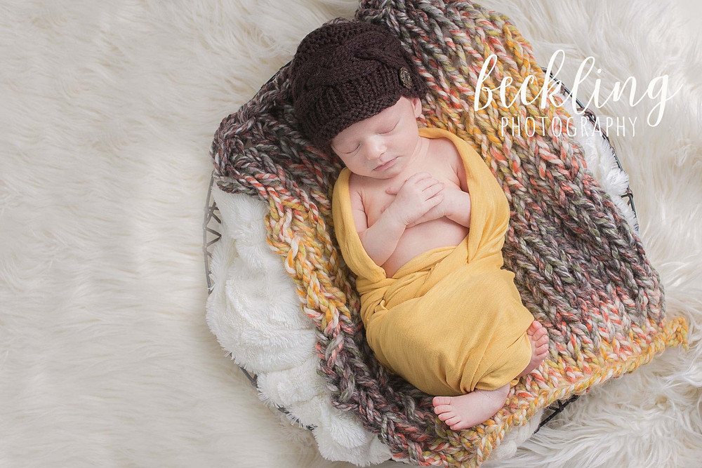 Beckling Photography | Savannah Newborn Photographer | Newborn girl with mustard wrap, brown hat, and fall colored knit bump blanket, Newborn Fall colors