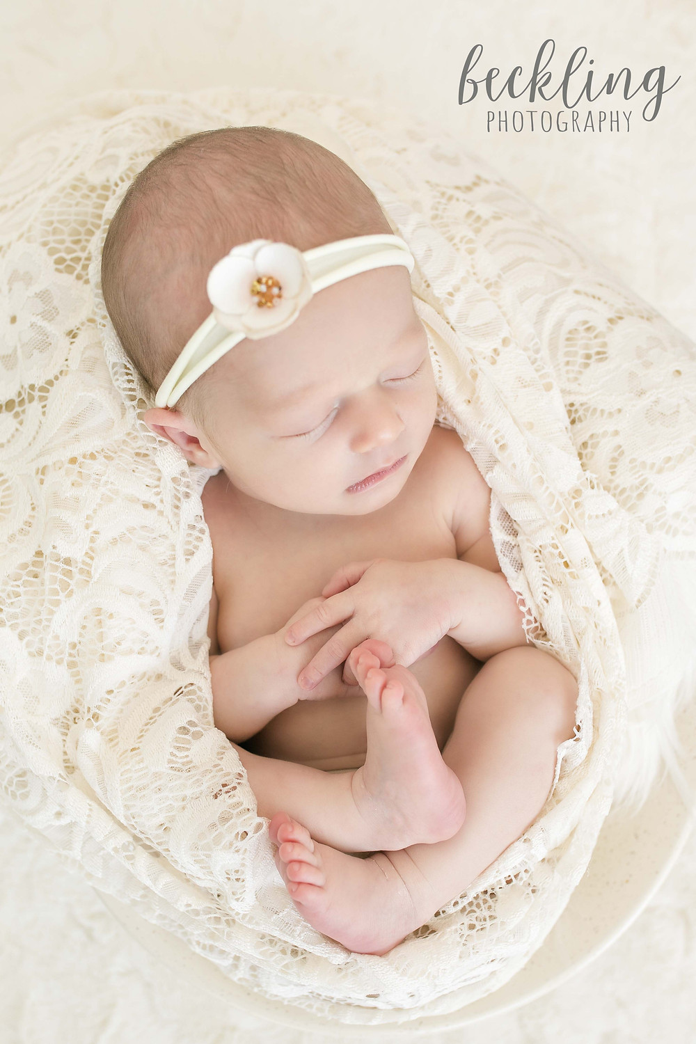 Beckling Photography | Savannah Newborn Photographer | Newborn girl with ivory lace wrap and flower headband