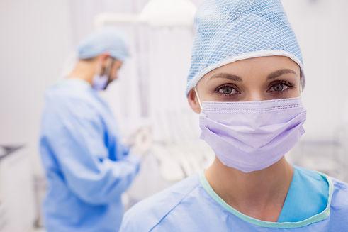 portrait-female-dentist-wearing-surgical