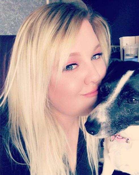 Amanda loving on her pup.