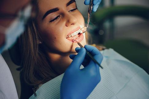 beautiful-girl-sitting-dentist-s-office.