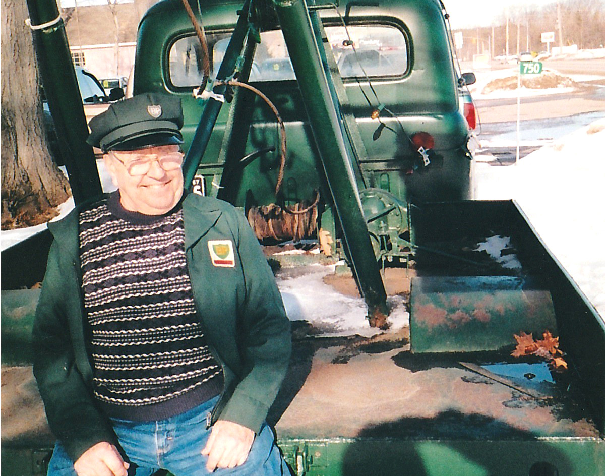Richard Lesperance with antique tow truck.