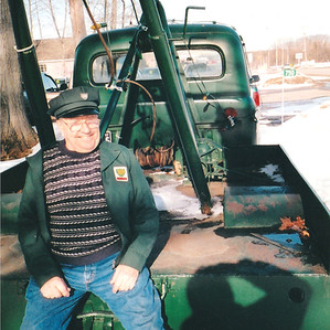 Richard Lesperance with an antique tow truck.