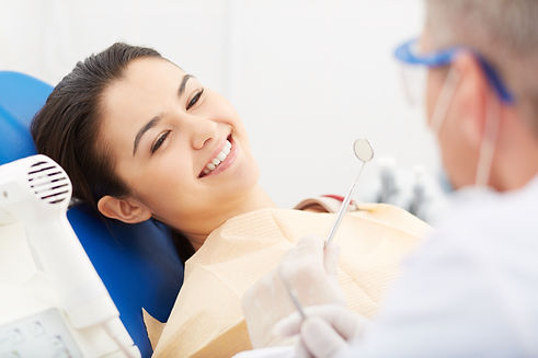 young-woman-receiving-dental-check-up.jp