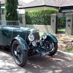 Brian McMillan's Aston parked around the corner