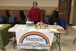 Friends of the Library table set up at Exeter Winter Farmers' Market