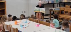 Ms Liz reading to children