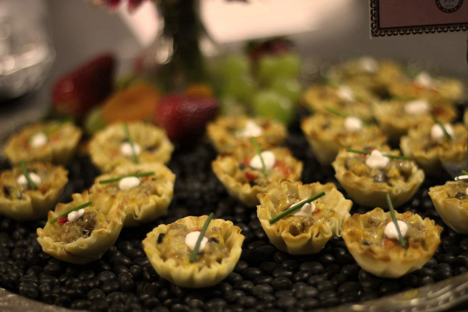 appetizer catering with quiche cups, sour cream, and dill