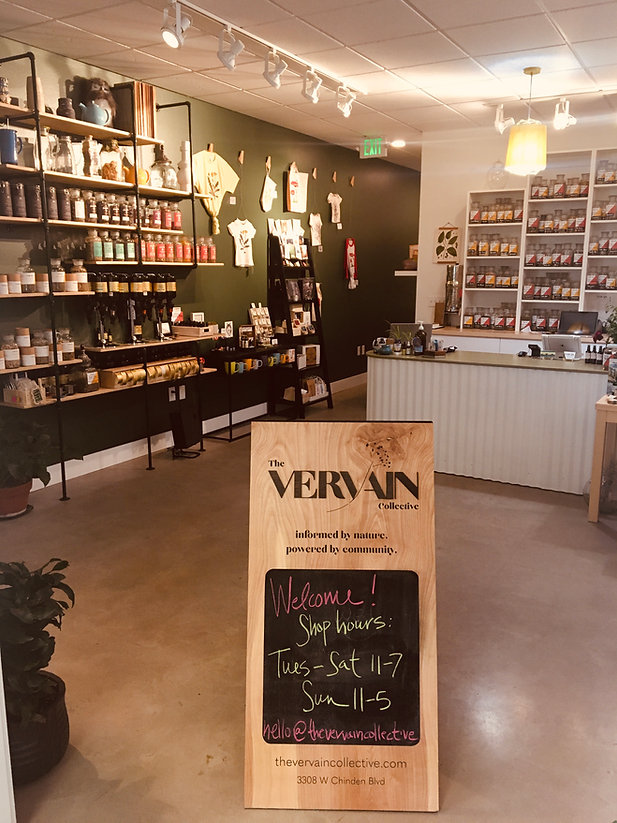 View of the shop from the front door facing in - tea wall, herb wall, etc.