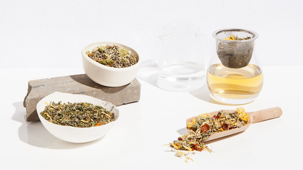 Dried flowers and leaves in tea blends, shown in display containers