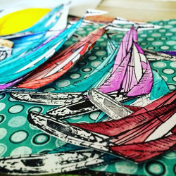 Getting ready for #ctmh convention swaps! A bunch of water colored, fussy-cut, stamped boats!  Might