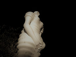 Picture of a modern sculpture of a pregnant woman