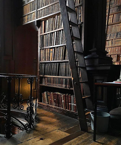 Photo of the old library in Trinity College Dublin, featuring old books on a bookshelf