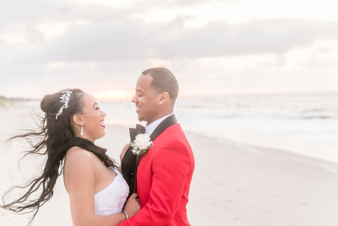 Bride and Groom Laugh on the Beach at Sunset